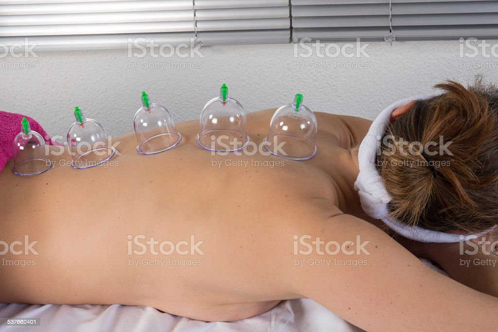 Therapist removing a glass globe stock photo