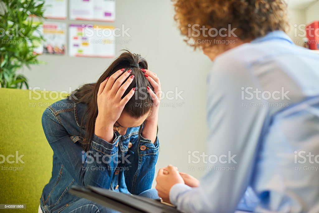 therapist session with young woman stock photo