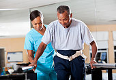 Therapist with patient doing gait training