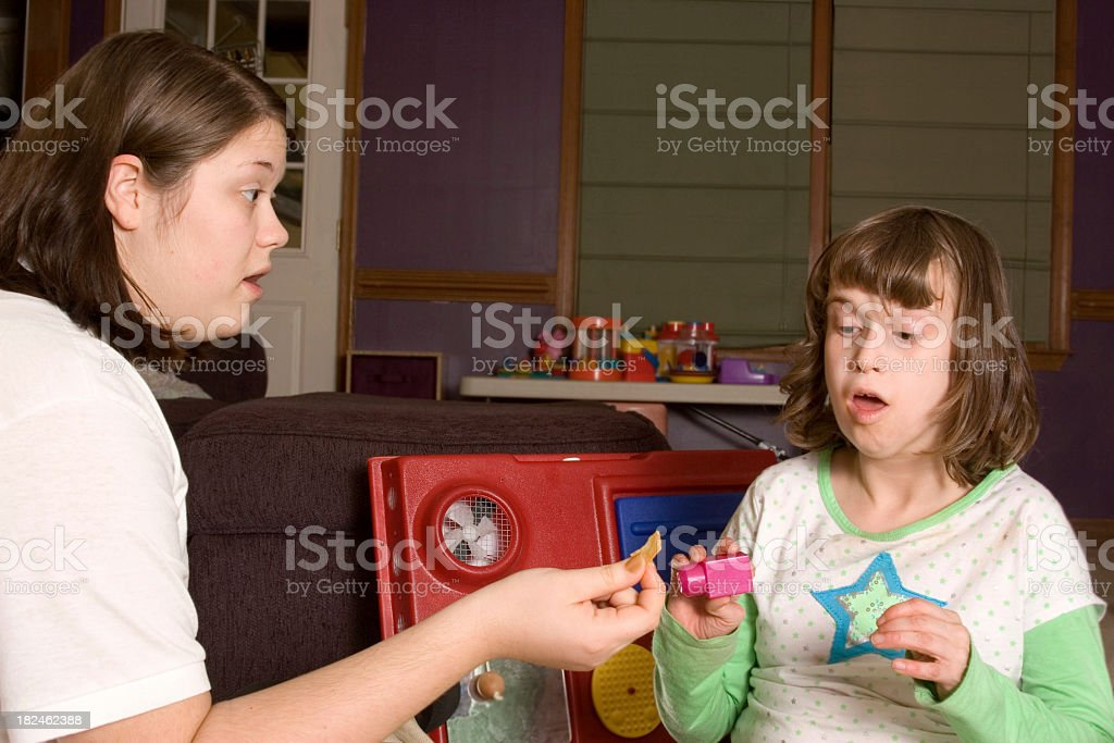 ABA therapist working with autistic little girl stock photo