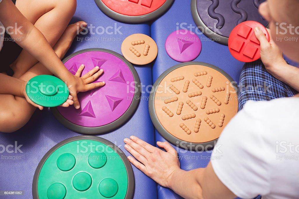 Therapy of sensory integration stock photo