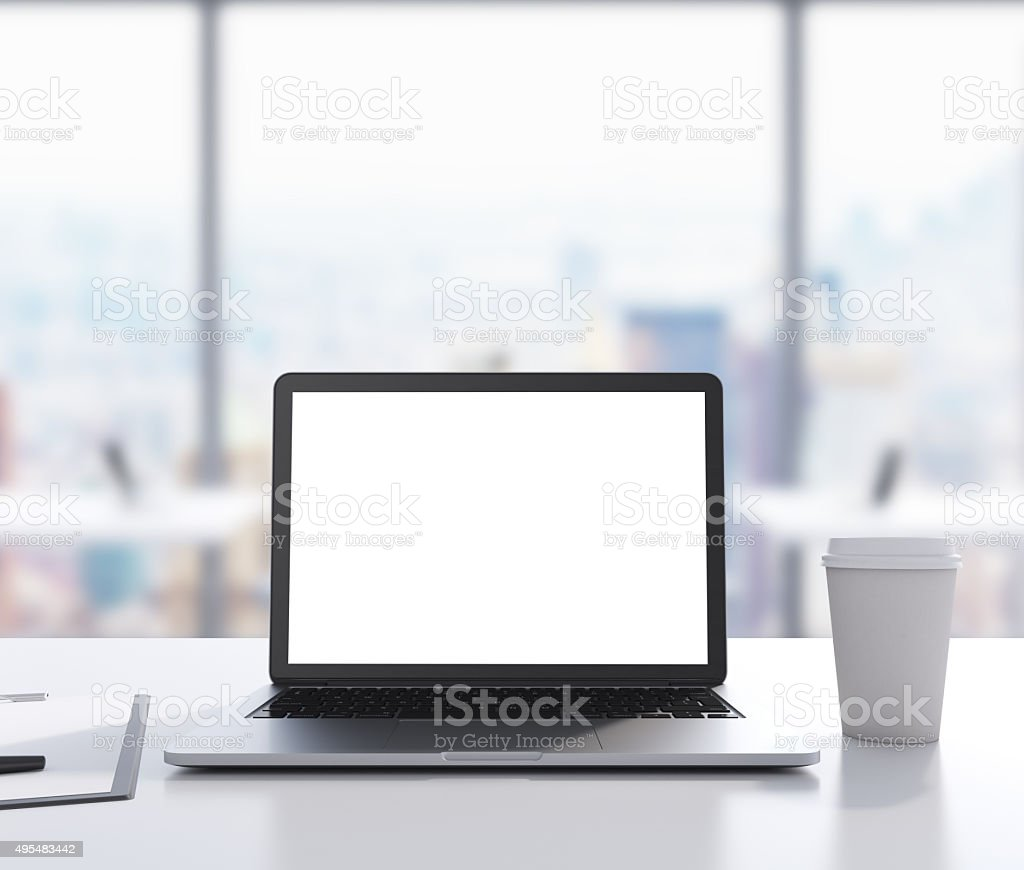 There are a laptop with white copy space screen stock photo