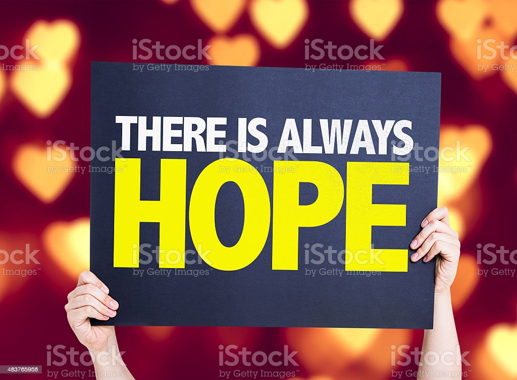 There Is Always Hope card with heart bokeh background stock photo