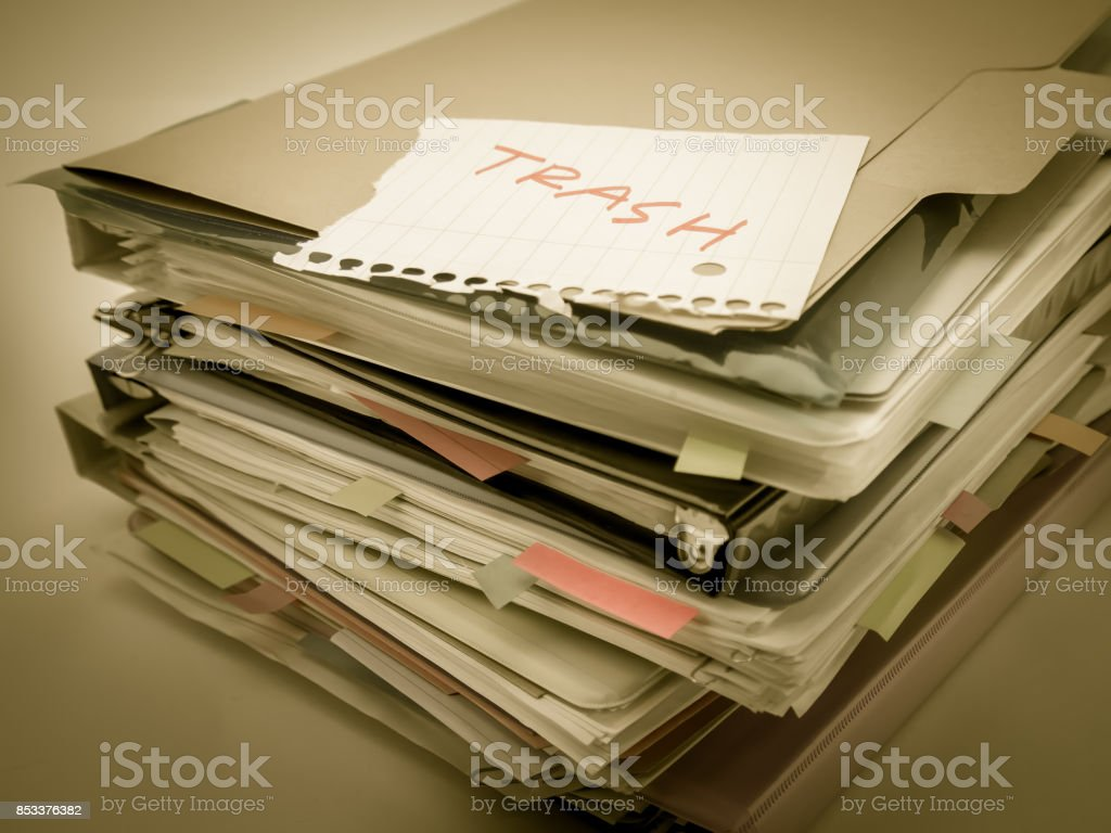There is the huge pile of business documents on the desk. stock photo