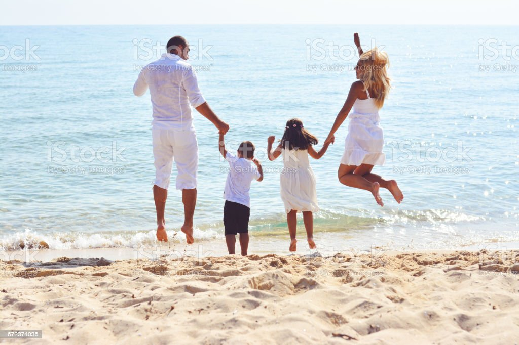 There's no hiding their love for the beach stock photo