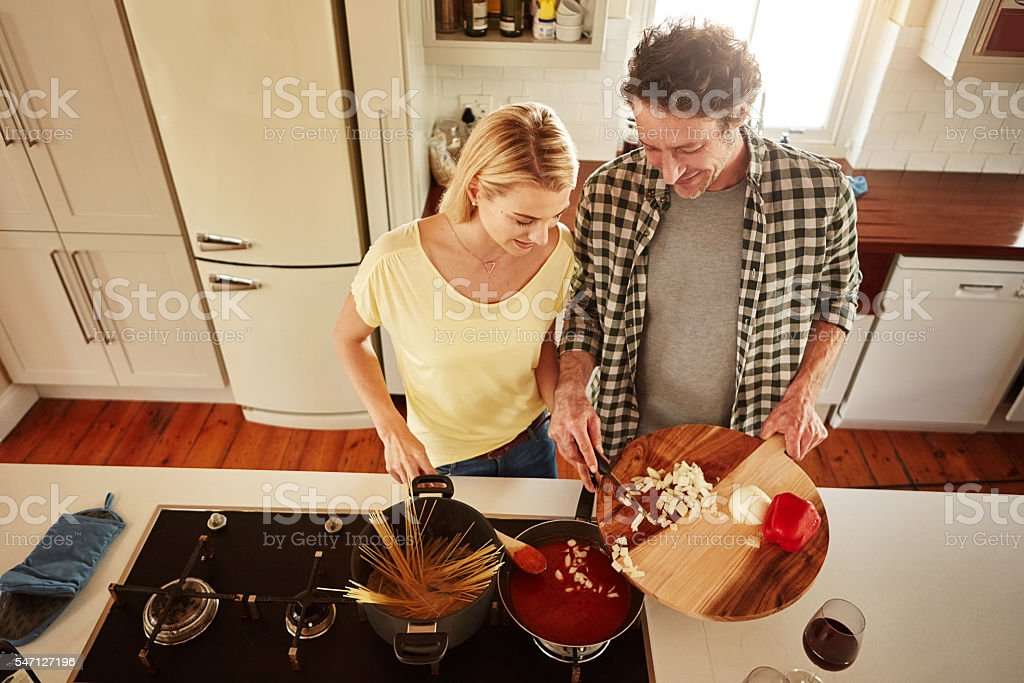 There's nothing more fun than cooking with your husband stock photo