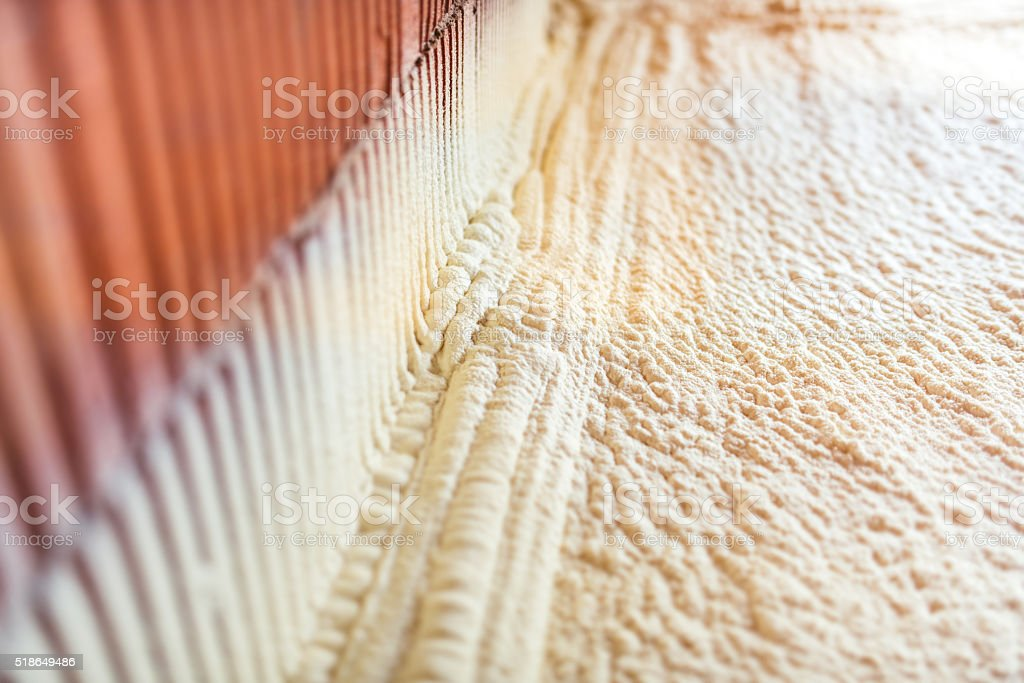 thermal and hydro insulation with spray foam stock photo