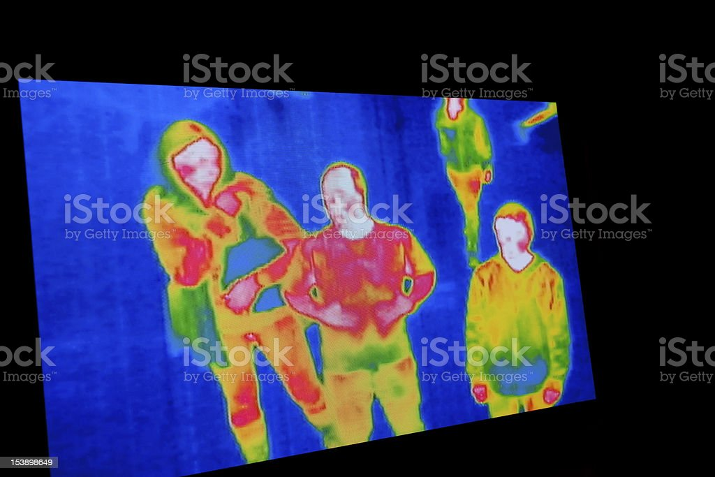 A thermal image of four people stock photo