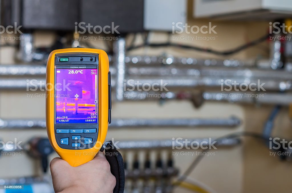 Thermal imaging inspection of heat system with tubes at house stock photo