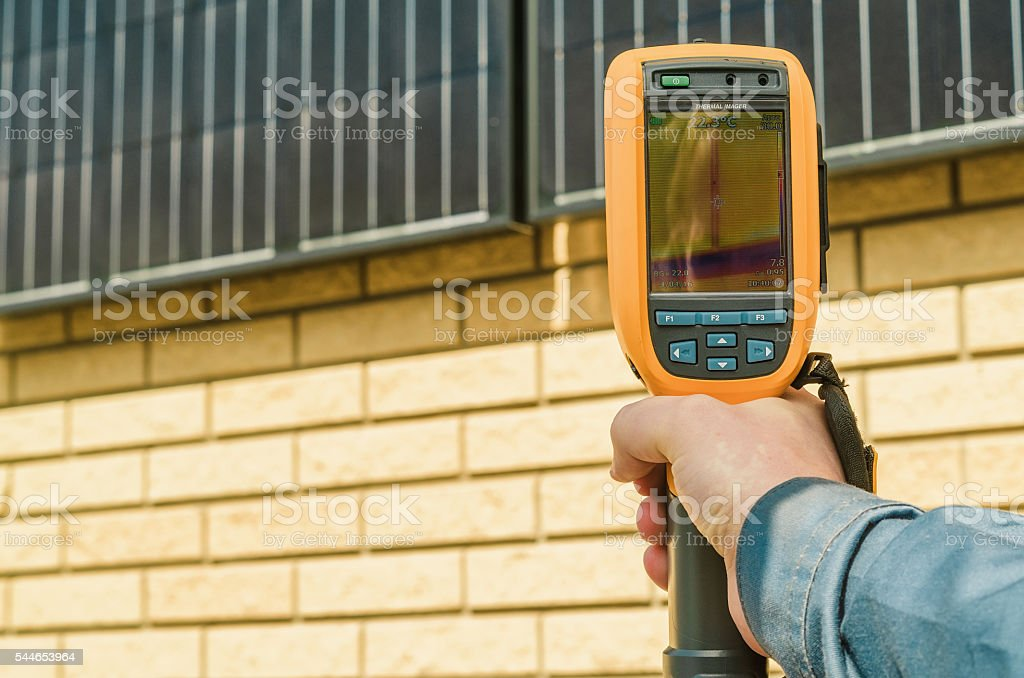 Thermal imaging of Photovoltaic Solar Panels on the Wall stock photo