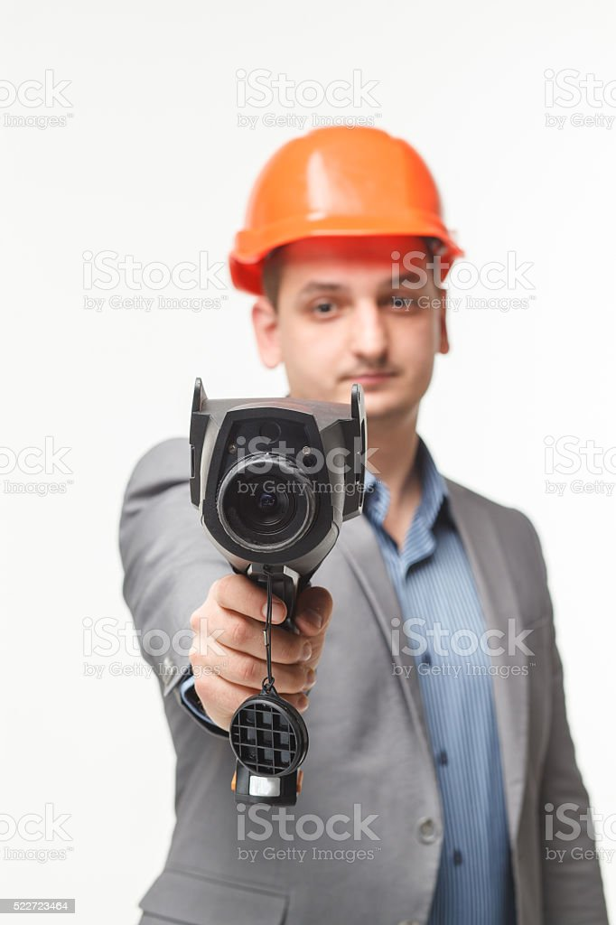 thermal instrument in man's hand stock photo
