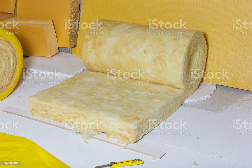 thermal insulation role in yellow package at attic background stock photo