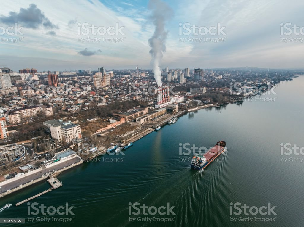 Thermal power plant on the river shore. stock photo