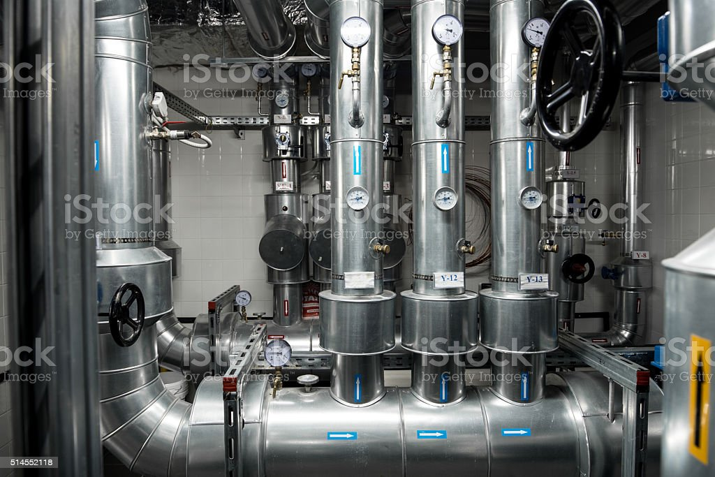 Thermal power plant piping at modern factory stock photo