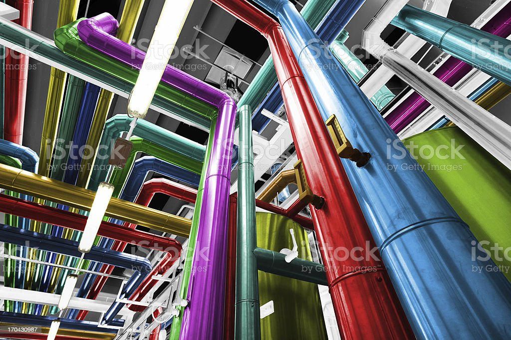 Thermal power plant with its pipes brightly colored stock photo