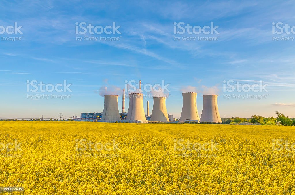 Thermal power plant with rape field stock photo