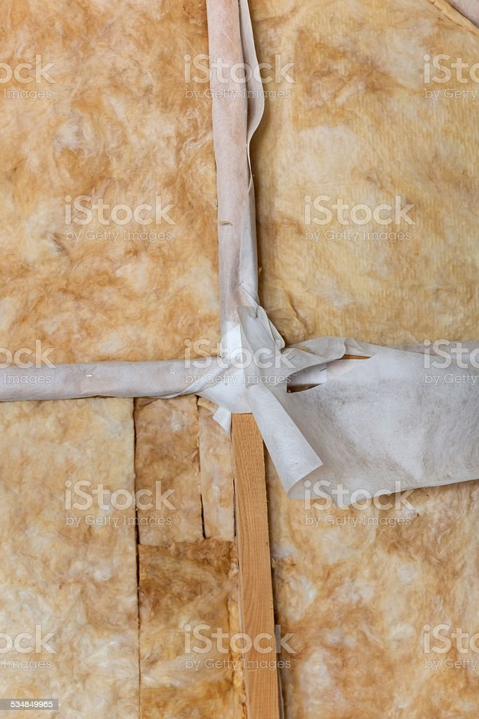 Thermally insulating house attic with mineral wool stock photo
