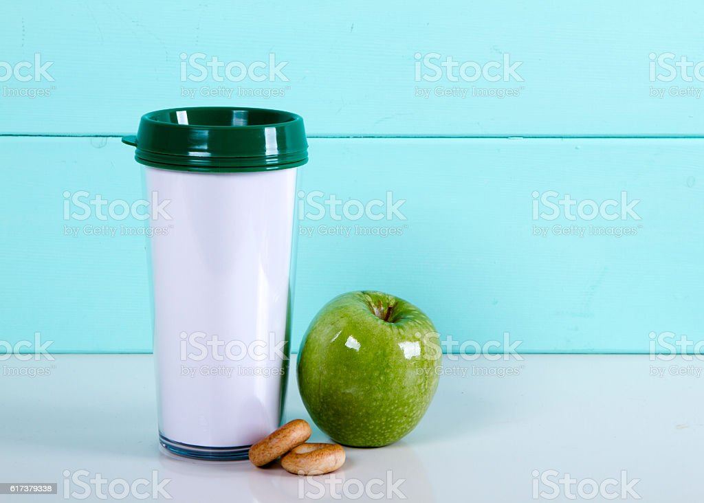 Thermocup apple bagels on a wooden blue background  the table stock photo