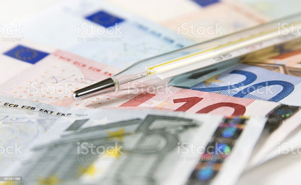 Thermometer and healthcare finances royalty-free stock photo