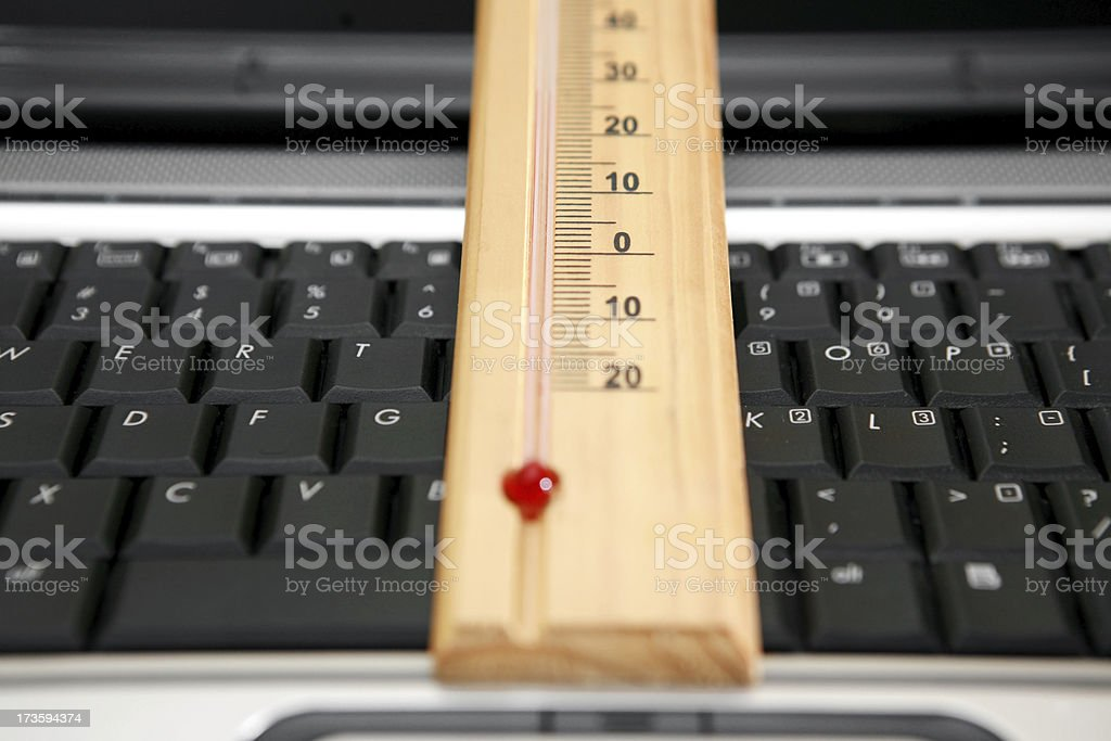 thermometer and laptop stock photo
