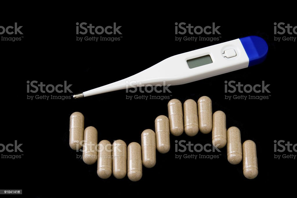 Thermometer and pills. royalty-free stock photo