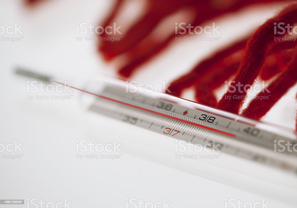 Thermometer And Scarf Fringes royalty-free stock photo
