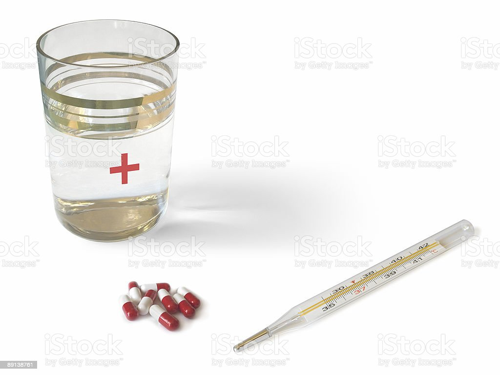 Thermometer, glass and pills royalty-free stock photo