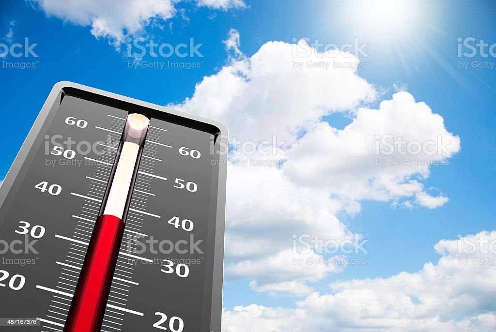 Thermometer heat close-up on sky stock photo