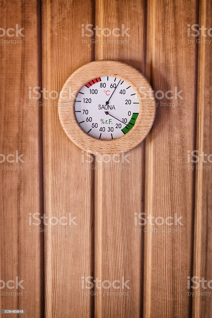thermometer inside sauna measuring temperature and air humidity stock photo