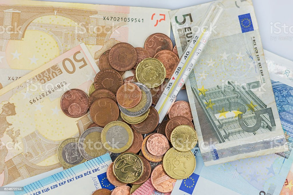 Thermometer on a pile of euros stock photo