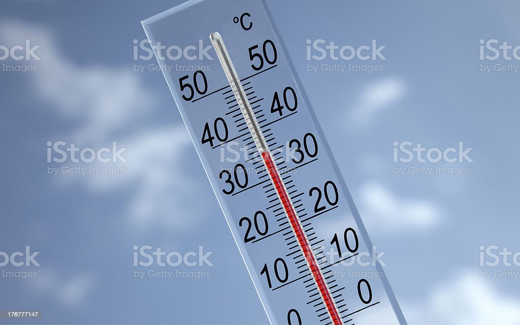 Thermometer on sky background 35°c stock photo