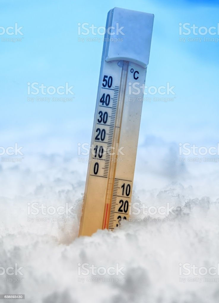 thermometer on snow stock photo