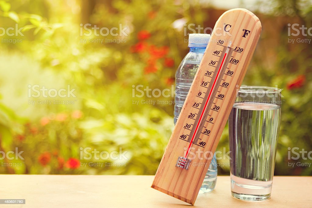 Thermometer on summer day showing near 45 degrees stock photo
