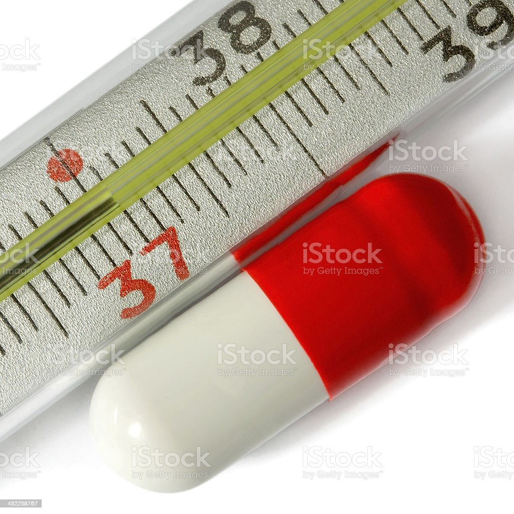 thermometer scale with red white pills royalty-free stock photo