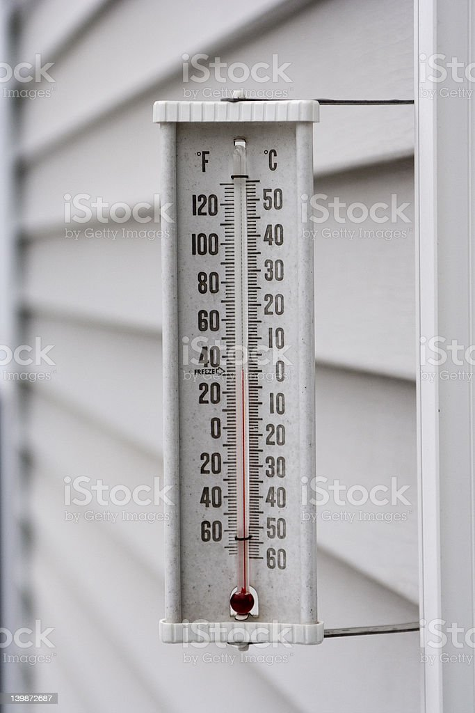 Thermometer showing freezing temp stock photo