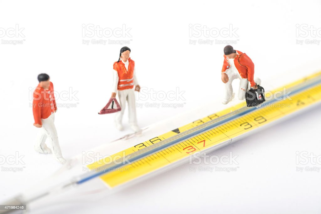 Thermometer with Celsius and small figurines stock photo