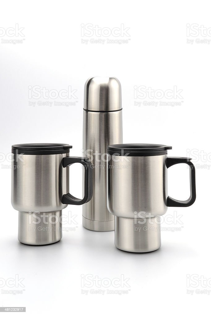 Thermos flask with two mugs stock photo
