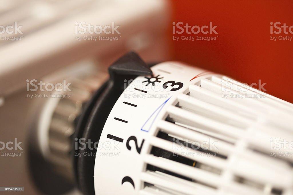 Thermostat on radiator stock photo