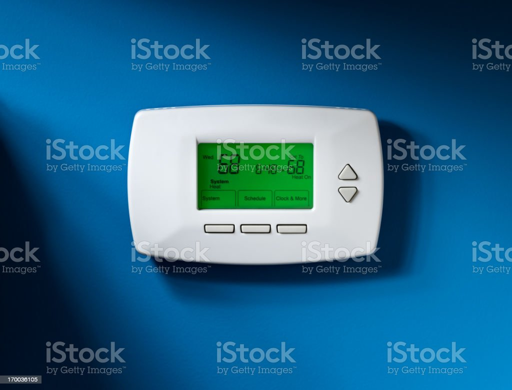 Thermostat, Programmable, Isolated on blue stock photo