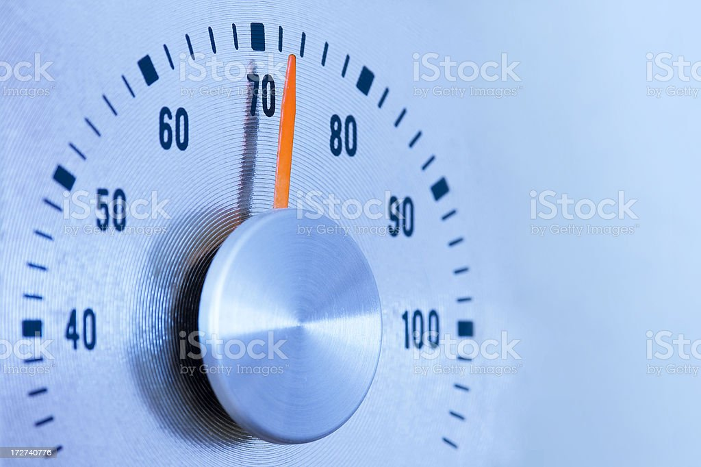 Thermostat Thermometer - 70 Degrees stock photo