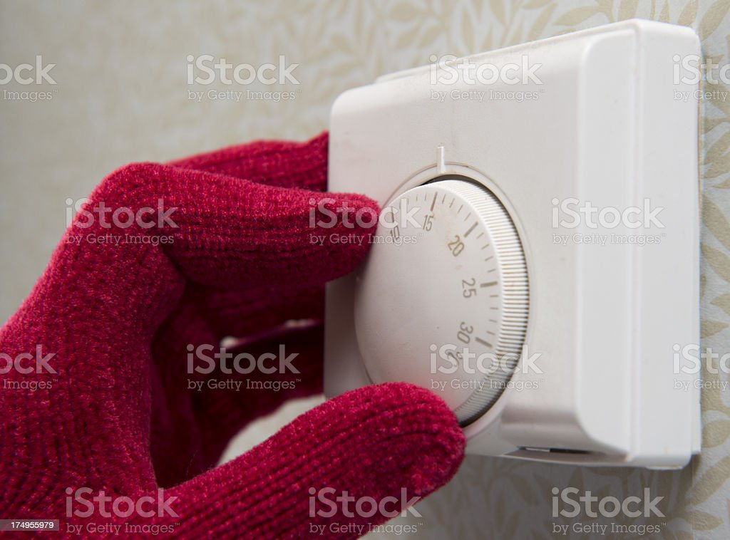 thermostat turned down stock photo