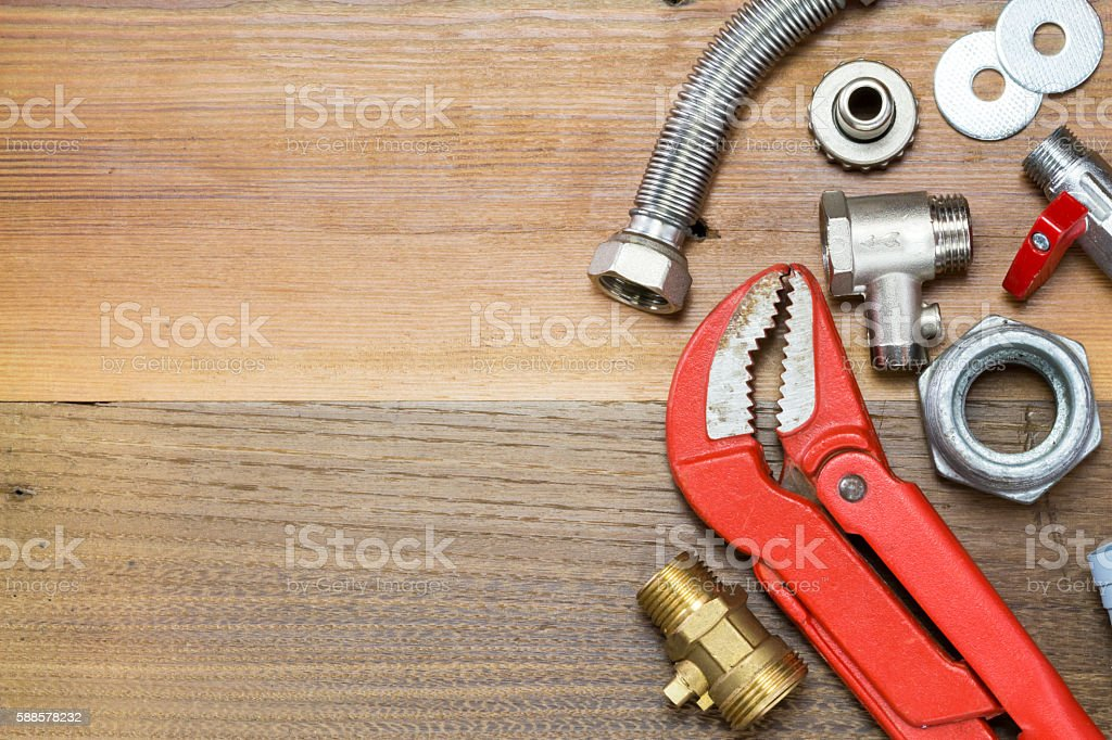 Thermostatic valve and plumber  tools on wooden background stock photo
