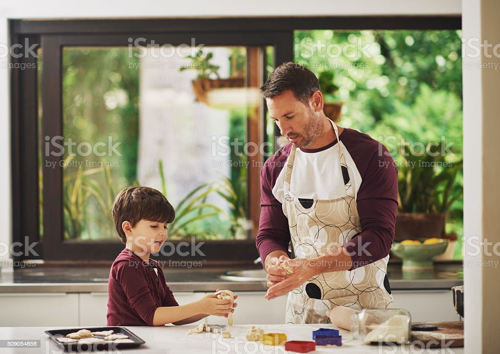 These boys love baking! stock photo