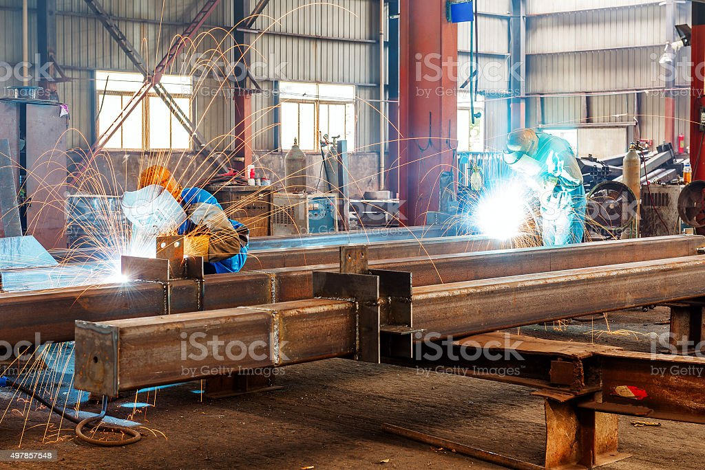 They are cut steel workers stock photo