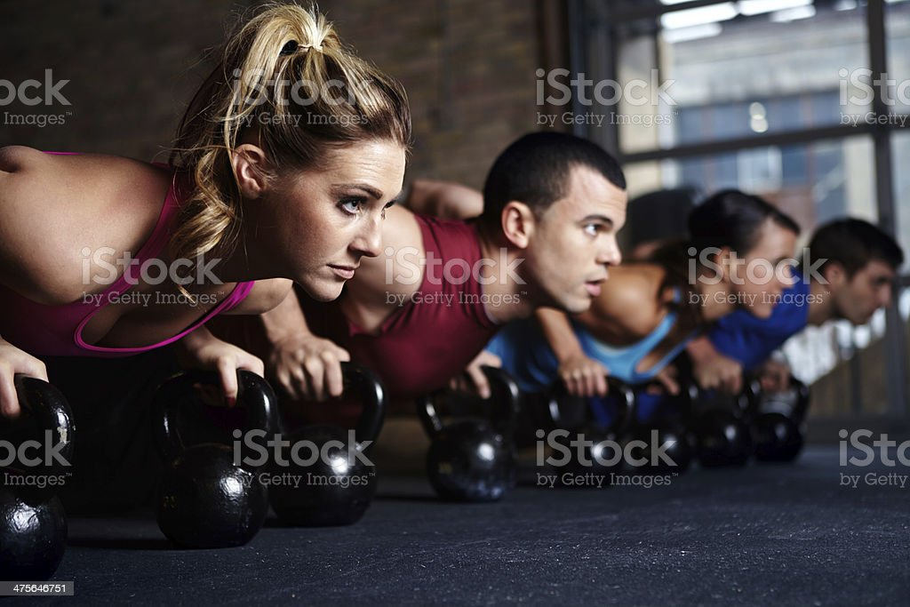 They attend the same weight training class stock photo