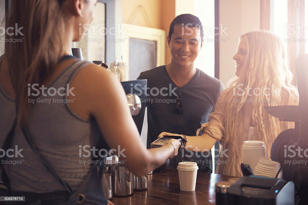 They come here for the coffee and the convenience stock photo