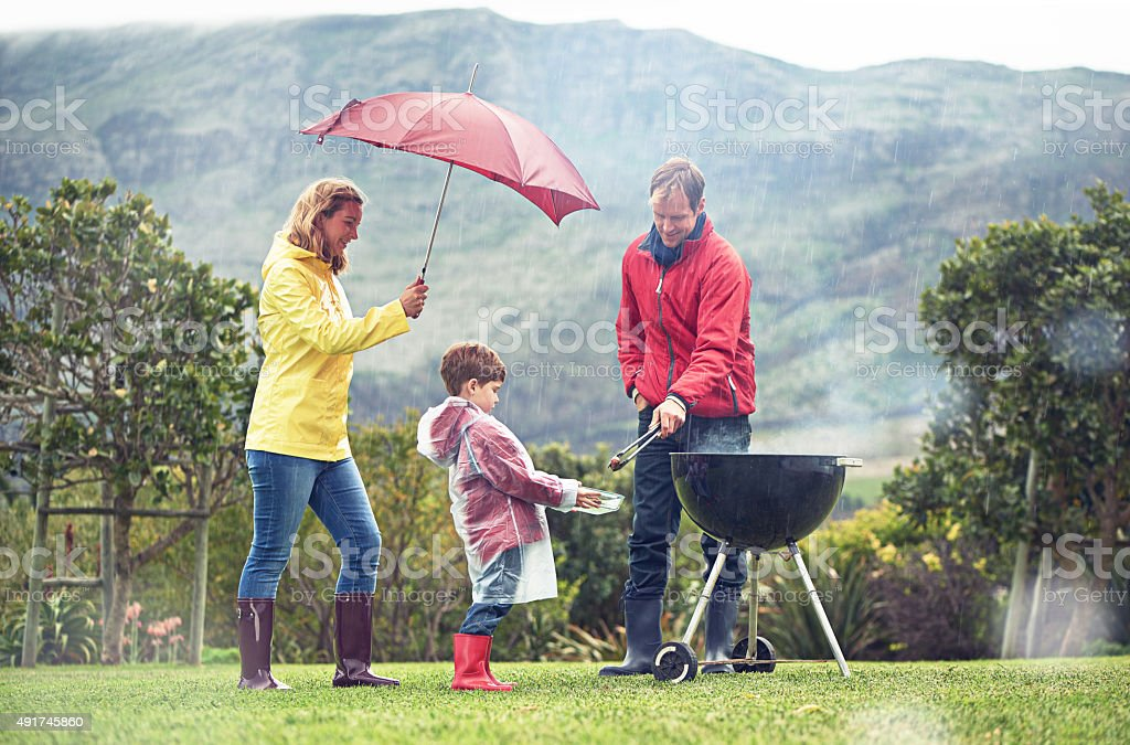 They didn't let a little rain spoil their barbecue stock photo