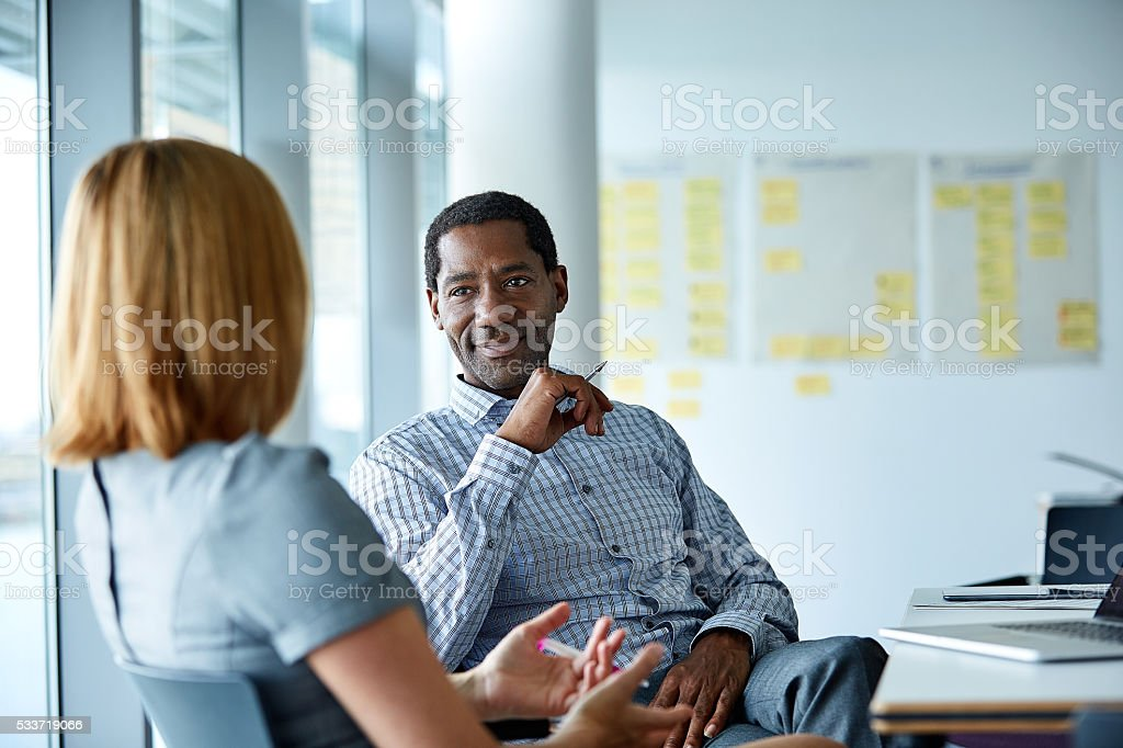 They enjoy a great working relationship stock photo