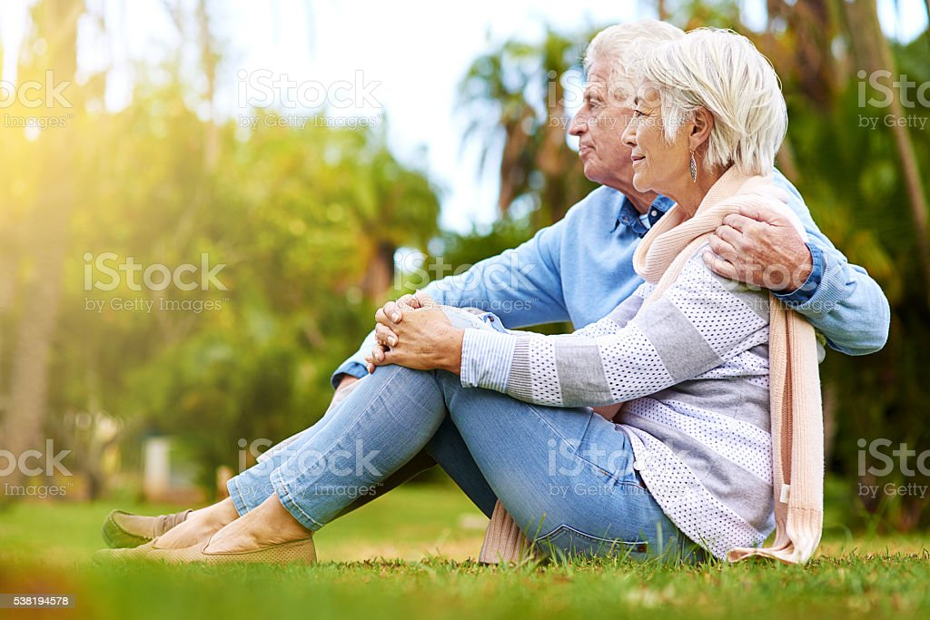 They enjoy the scenery in the park stock photo