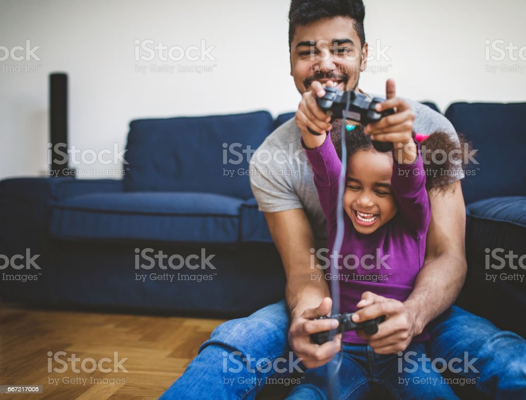 They get so excited when they play games stock photo